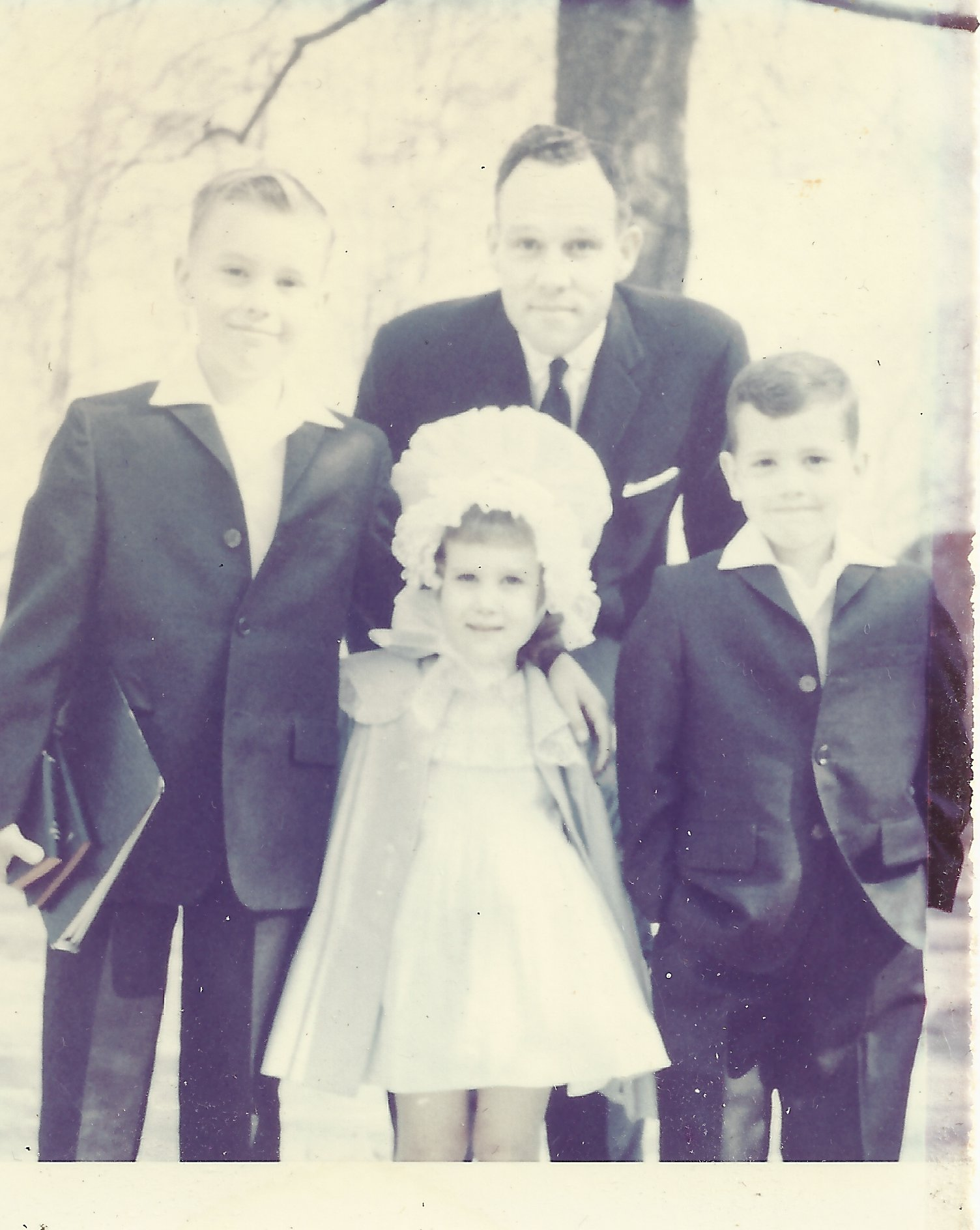 My brothers Adam and Spencer, my Dad and me at Easter, circa 1959 or 1960
