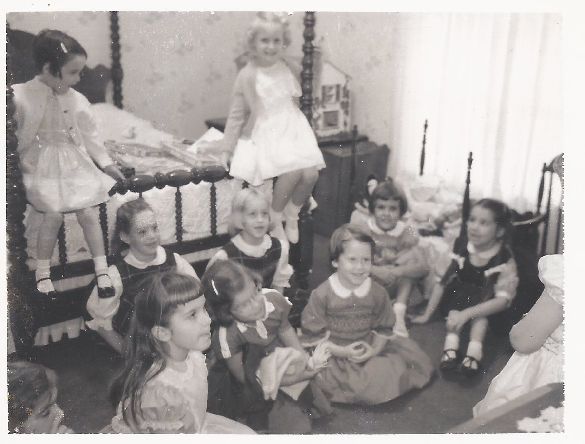 My 6th birthday party.  If you look close, at the very bottom right edge, you can see it.  The dressing table cloth!  I am leaning on the dressing table, commanding my own party I imagine!