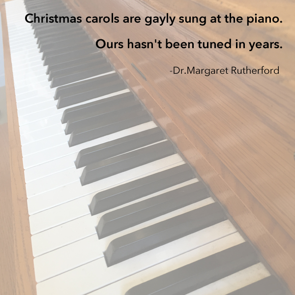 Christmas carols are gayly sung at the piano. Ours hasn't been tuned in years
